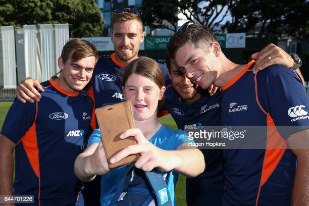 Tom Latham Tim Southee Mitchell Santner and Ross Taylor pose for a selfie with thirteenyearold Erin Buckland who is 'flying the flag' for females in...