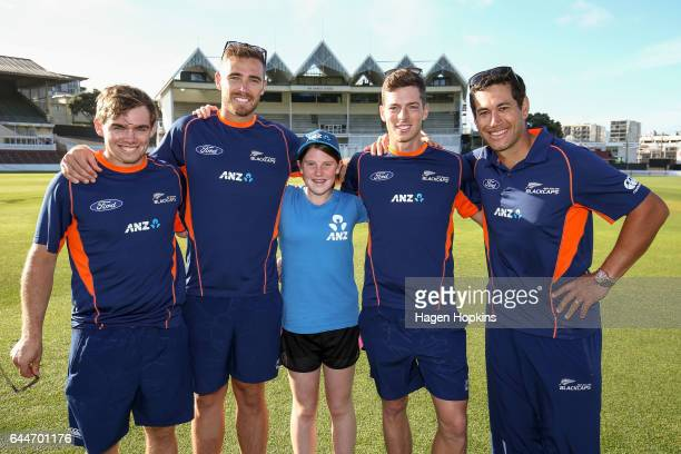 Tom Latham Tim Southee Mitchell Santner and Ross Taylor pose with thirteenyearold Erin Buckland who is 'flying the flag' for females in cricket...