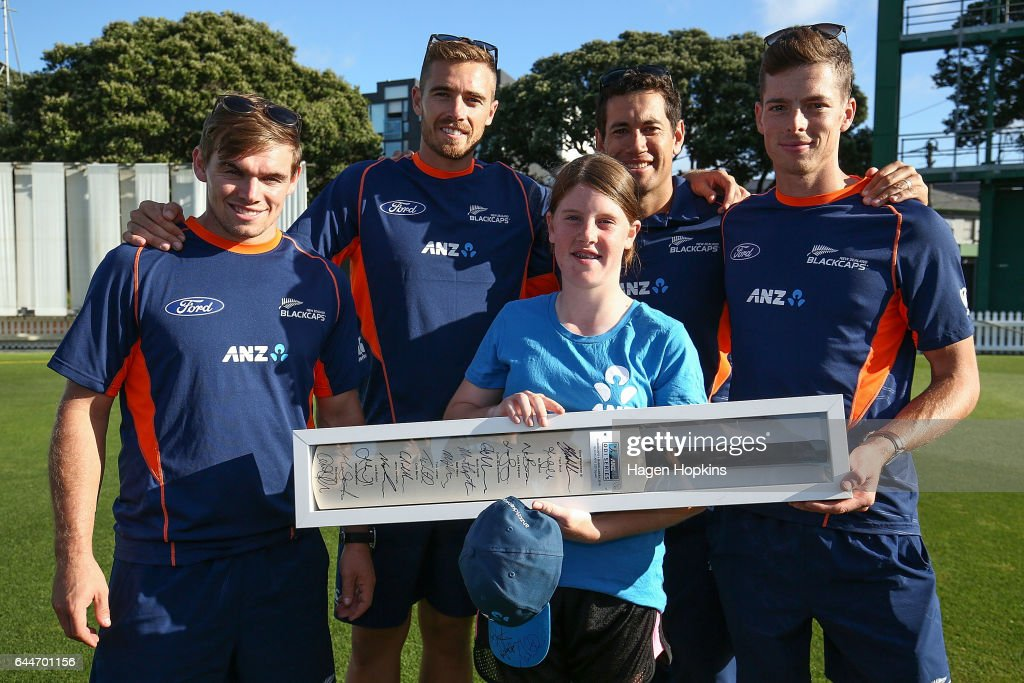 Tom Latham, Tim Southee, Mitchell Santner and Ross Taylor present a signed bat to thirteen-year-old Erin Buckland who is 'flying the flag' for females in cricket during the ANZ Dream Deliveries programme at Basin Reserve on February 23, 2017 in Wellington, New Zealand.