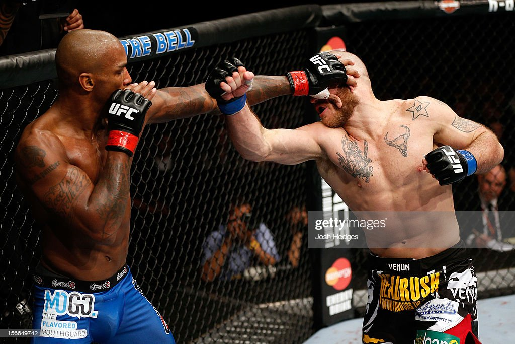 Tom Lawlor (R) fights against Francis Carmont in their middleweight bout during UFC 154 on November 17, 2012 at the Bell Centre in Montreal, Canada.