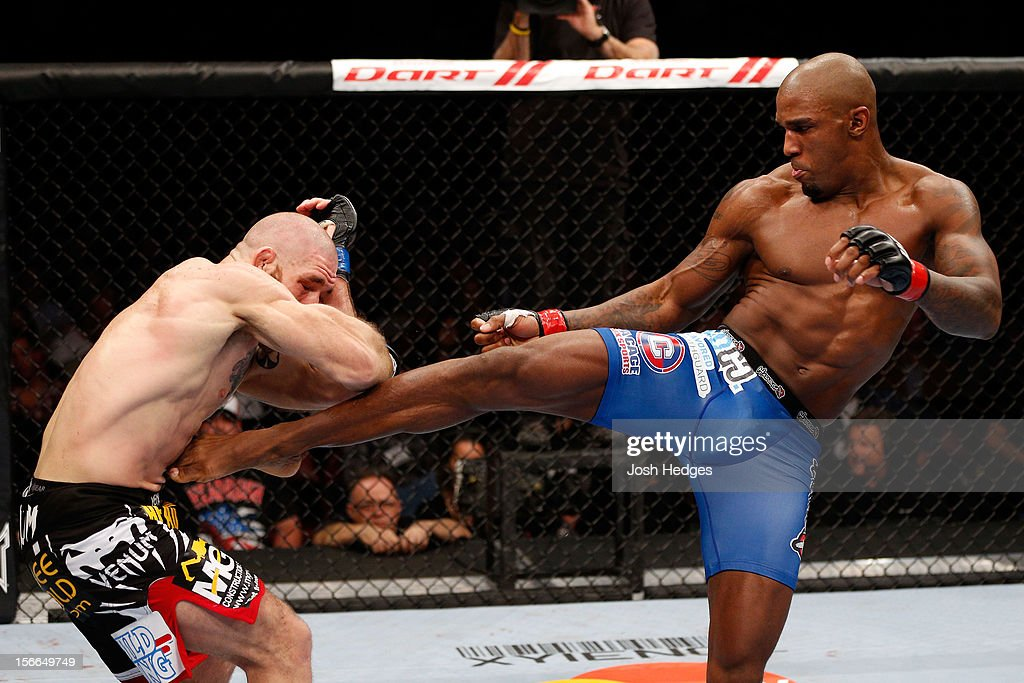 Tom Lawlor (L) fights against Francis Carmont in their middleweight bout during UFC 154 on November 17, 2012 at the Bell Centre in Montreal, Canada.