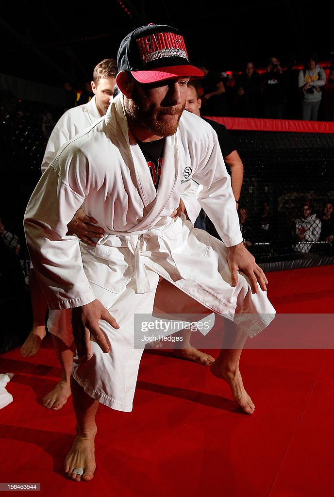 Tom Lawlor performs a sumo workout routine for media and fans during an open training session ahead of UFC 154 at New City Gas on November 15, 2012 in Montreal, Quebec, Canada.