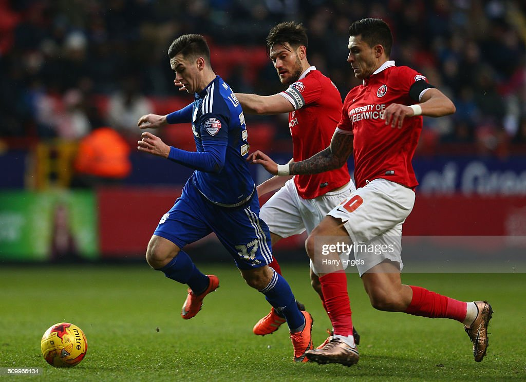 Tom Lawrence of Cadiff (L) is challenged by Johnnie Jackson (C) and Jorge Teixeira (R) of Charlton during the Sky Bet Championship match between Charlton Athletic and Cardiff City at The Valley on February 13, 2016 in London, United Kingdom.