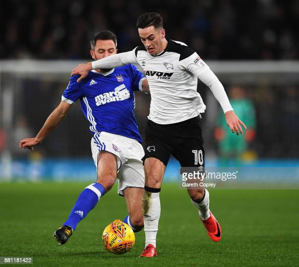 Tom Lawrence of Derby County battles for the ball with Cole Skuse of Ipswich Town during the Sky Bet Championship match between Derby County and...