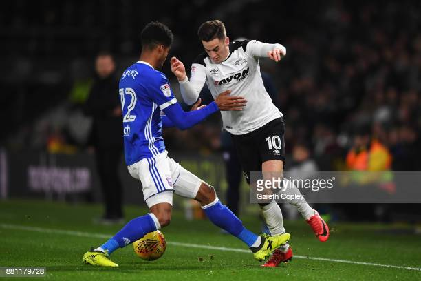 Tom Lawrence of Derby County battles for the ball with Jordan Spence of Ipswich Town during the Sky Bet Championship match between Derby County and...