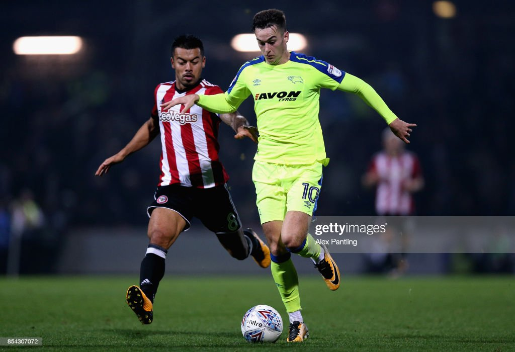 Tom Lawrence of Derby County is chased down by Nico Yennaris of Brentford during the Sky Bet Championship match between Brentford and Derby County at Griffin Park on September 26, 2017 in Brentford, England.