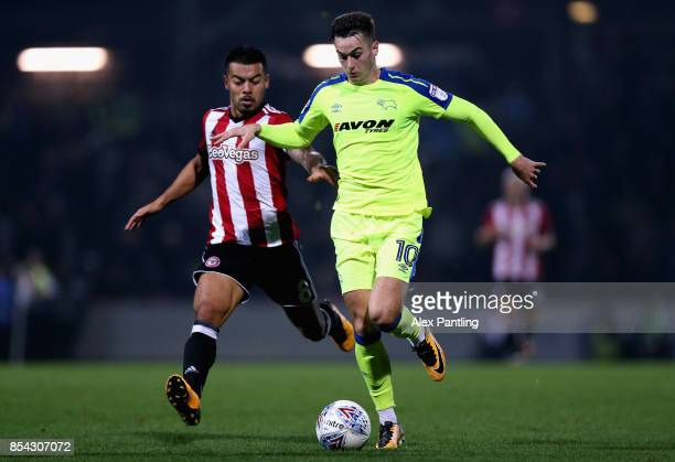 Tom Lawrence of Derby County is chased down by Nico Yennaris of Brentford during the Sky Bet Championship match between Brentford and Derby County at...