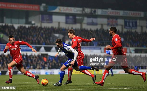 Tom Lawrence of Ipswich Town and Luke Freeman of Bristol City compete for the ball during the Sky Bet Championship match between Ipswich Town and...