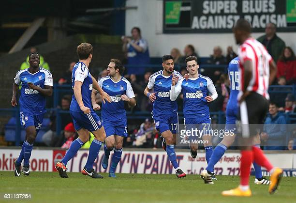 Tom Lawrence of Ipswich Town celebrates with team mates after scoring his sides first goal during the Emirates FA Cup third round match between...