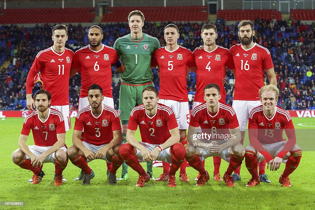 Tom Lawrence of Wales, <a gi-track='captionPersonalityLinkClicked' href=/galleries/search?phrase=Ashley+Williams+-+Fotbollsspelare&family=editorial&specificpeople=13495389 ng-click='$event.stopPropagation()'>Ashley Williams</a> of Wales, goalkeeper <a gi-track='captionPersonalityLinkClicked' href=/galleries/search?phrase=Wayne+Hennessey&family=editorial&specificpeople=4304710 ng-click='$event.stopPropagation()'>Wayne Hennessey</a> of Wales, <a gi-track='captionPersonalityLinkClicked' href=/galleries/search?phrase=James+Chester&family=editorial&specificpeople=4192570 ng-click='$event.stopPropagation()'>James Chester</a> of Wales, <a gi-track='captionPersonalityLinkClicked' href=/galleries/search?phrase=Ben+Davies+-+Fotbollsspelare+-+F%C3%B6dd+1993&family=editorial&specificpeople=13494398 ng-click='$event.stopPropagation()'>Ben Davies</a> of Wales, <a gi-track='captionPersonalityLinkClicked' href=/galleries/search?phrase=Joe+Ledley&family=editorial&specificpeople=687410 ng-click='$event.stopPropagation()'>Joe Ledley</a> of Wales <a gi-track='captionPersonalityLinkClicked' href=/galleries/search?phrase=Joe+Allen+-+Walesisk+fotbollsspelare&family=editorial&specificpeople=9629091 ng-click='$event.stopPropagation()'>Joe Allen</a> of Wales, Neil Taylor of Wales, Chris Gunter of Wales, <a gi-track='captionPersonalityLinkClicked' href=/galleries/search?phrase=Andy+King+-+Fotbollsspelare+-+F%C3%B6dd+1988&family=editorial&specificpeople=14622523 ng-click='$event.stopPropagation()'>Andy King</a> of Wales, Jonathan Williams of Wales during the International friendly match between Wales and Netherlands on November 13, 2015 at the Cardiff City stadium in Cardiff, Wales.
