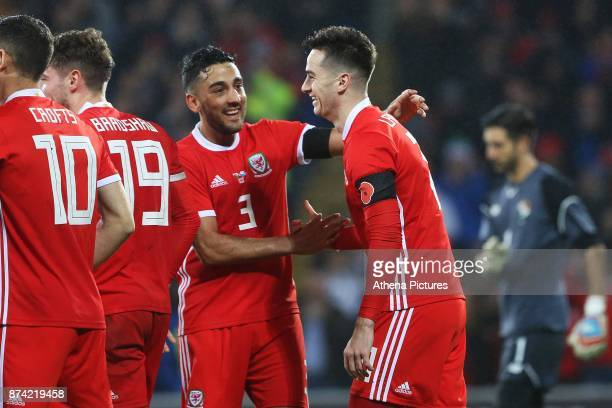 Tom Lawrence of Wales celebrates scoring his sides first goal of the match with Neil Taylor during the International Friendly match between Wales and...