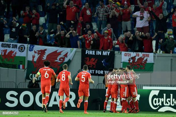 Tom Lawrence of Wales celebrates scoring the opening goal with teammates infront of Wales fans during the FIFA 2018 World Cup Qualifier between...