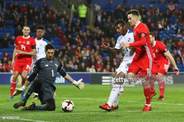 Tom Lawrence of Wales has a shot on goal saved by Jaime Penedo of Panama during the International Friendly match between Wales and Panama at The...