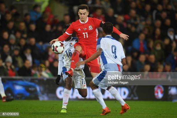 Tom Lawrence of Wales in action with Leslie Heraldez and Gabriel Torres of Panama during the International match between Wales and Panama at Cardiff...