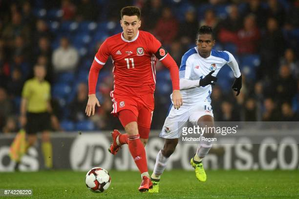 Tom Lawrence of Wales in action with Leslie Heraldez of Panama during the International match between Wales and Panama at Cardiff City Stadium on...