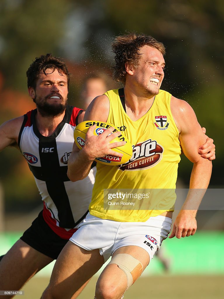 Tom Lee of the Saints breaks free of a tackle during the St Kilda Saints AFL Intra-Club Match at Trevor Barker Beach Oval on February 12, 2016 in Melbourne, Australia.