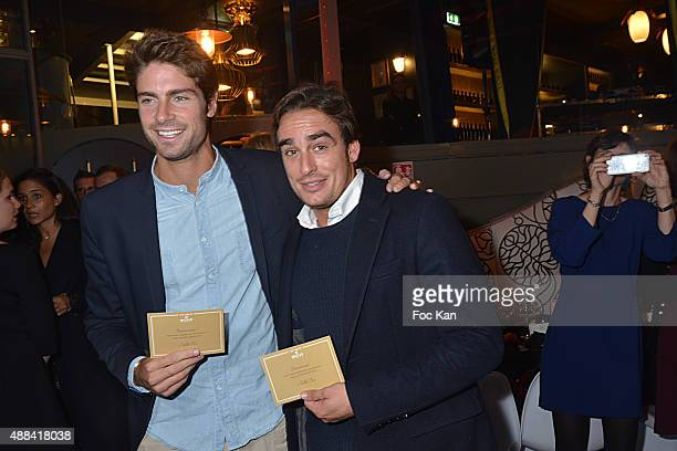 Tom Leeb and a friend attend the 'Diner Sensoriel' hosted by Maille at Jardin du Pont Neuf on September 15 2015 in Paris France