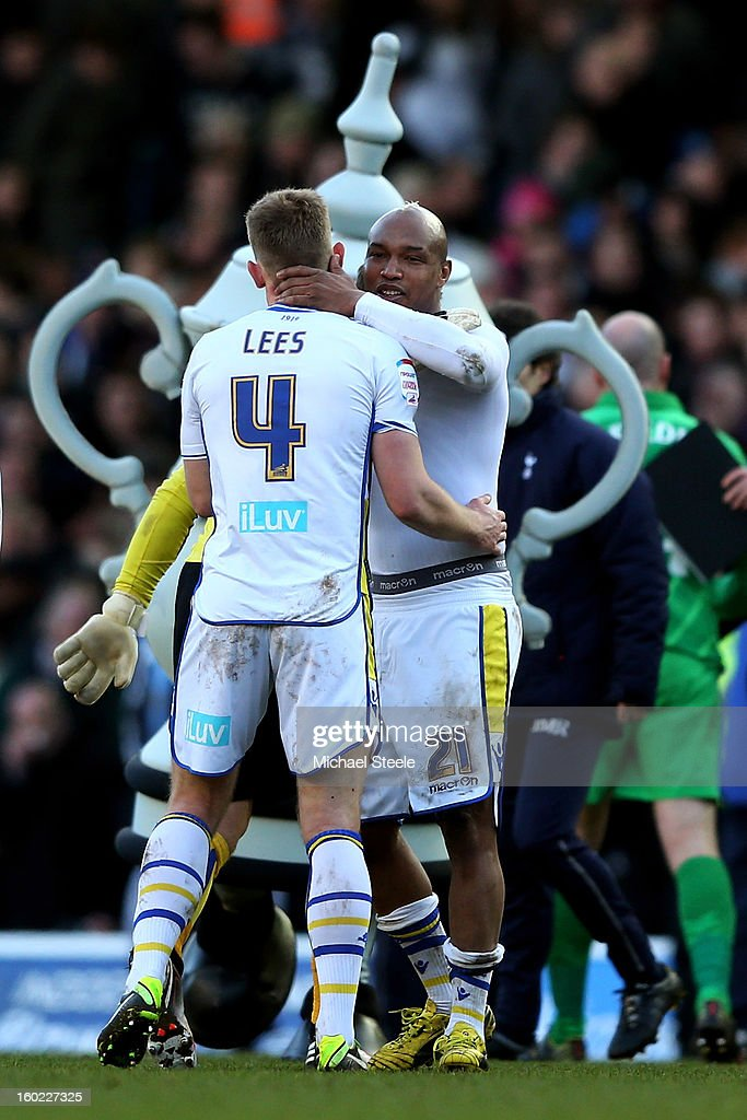 Tom Lees and El-Hadji Diouf of Leeds celebrate their team's 2-1 victory during the FA Cup with Budweiser Fourth Round match between Leeds United and Tottenham Hotspur at Elland Road on January 27, 2013 in Leeds, England.
