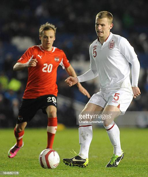 Tom Lees of England plays a pass back during the International match between England U21 and Austria U21 at The Amex Stadium on March 25 2013 in...