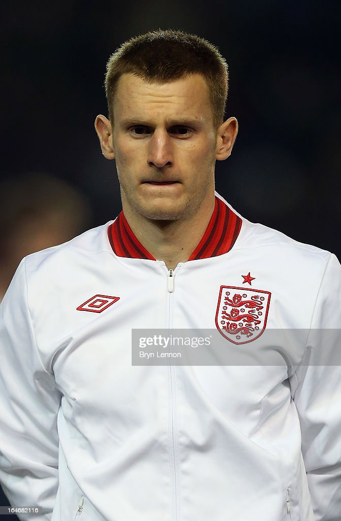 Tom Lees of England stands for the national athems ahead during the International Friendly match between England U21 and Austria U21 at Amex Stadium on March 25, 2013 in Brighton, England.