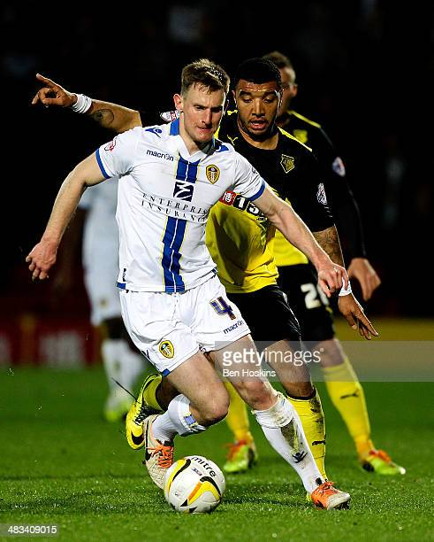 Tom Lees of Leeds holds off pressure from Troy Deeney of Watford during the Sky Bet Championship match between Watford and Leeds United at Vicarage...
