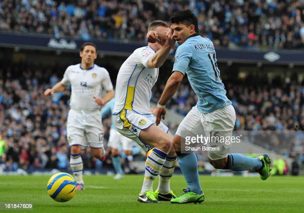 Tom Lees of Leeds United fouls Sergio Aguero of Manchester City to concede a penalty kick during the FA Cup with Budweiser Fifth Round match between...