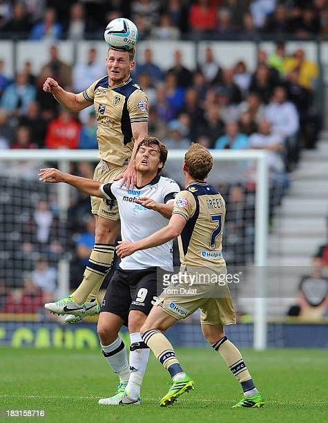 Tom Lees of Leeds United jumps to the ball during the Sky Bet Championship match between Derby County and Leeds United at Pride Park Stadium on...