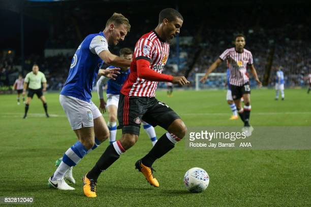 Tom Lees of Sheffield Wednesday and Lewis Grabban of Sunderland during the Sky Bet Championship match between Sheffield Wednesday and Sunderland at...