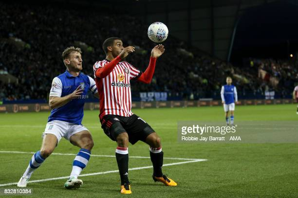Tom Lees of Sheffield Wednesday and Lewis Grabban of Sunderlandmduring the Sky Bet Championship match between Sheffield Wednesday and Sunderland at...