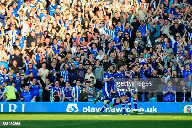 Tom Lees of Sheffield Wednesday celebrates with teammates after scoring the opening goal during the Sky Bet Championship Match between Sheffield...