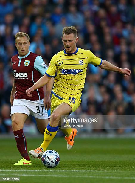 Tom Lees of Sheffield Wednesday in action with Scott Arfield of Burnley during the Capital One Cup Second Round match between Burnley and Sheffield...