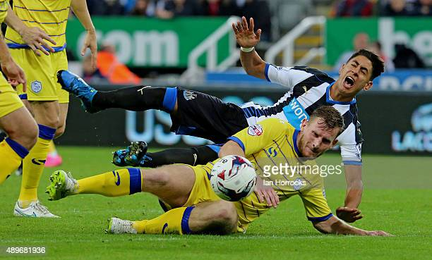 Tom Lees of Sheffield Wednesday tackles Ayoze Perez of Newcastle during the Capital One Cup third round match between Newcastle United and Sheffield...