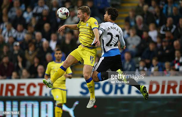 Tom Lees of Sheffield Wednesday vies with Daryl Janmaat of Newcastle United during the Capital One Cup Third Round match between Newcastle United and...
