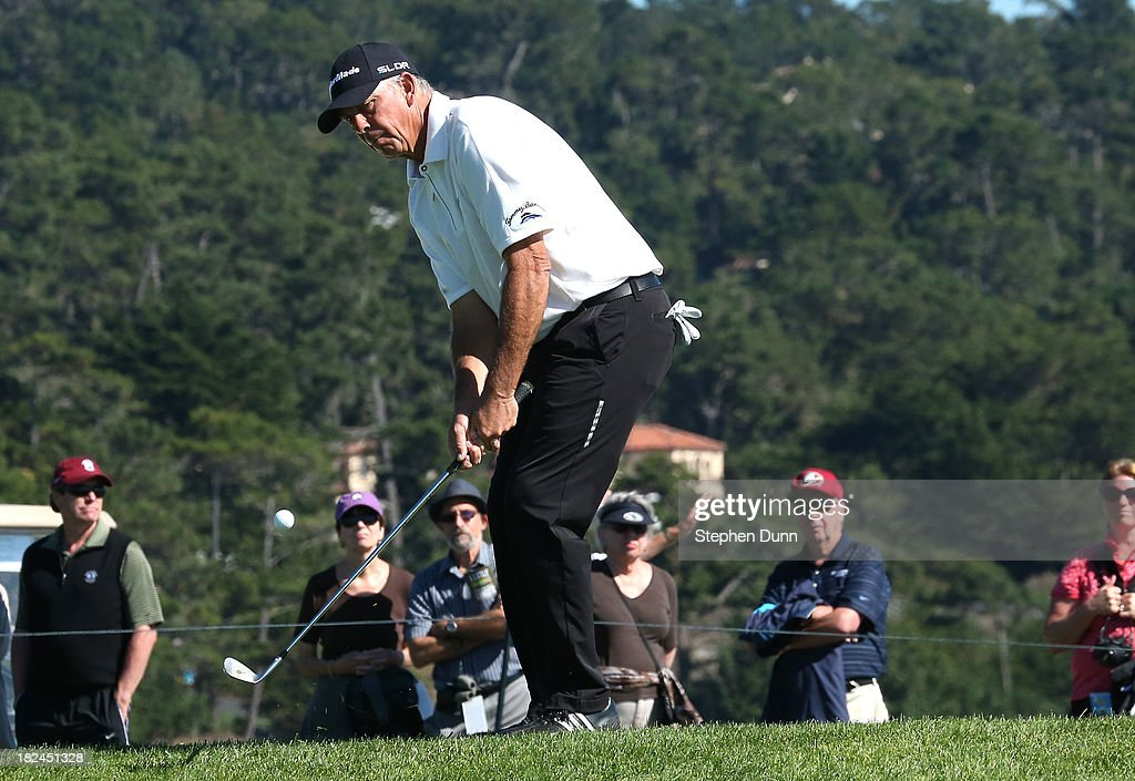 Tom Lehman chips onto the green on the sixth hole durng the final round of the Nature Valley First Tee Open at Pebble Beach at Pebble Beach Golf Links on September 29, 2013 in Pebble Beach, California.