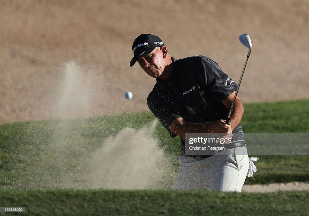 Tom Lehman chips out of the bunker onto the 18th hole green during the third round of the Charles Schwab Cup Championship on the Cochise Course at...