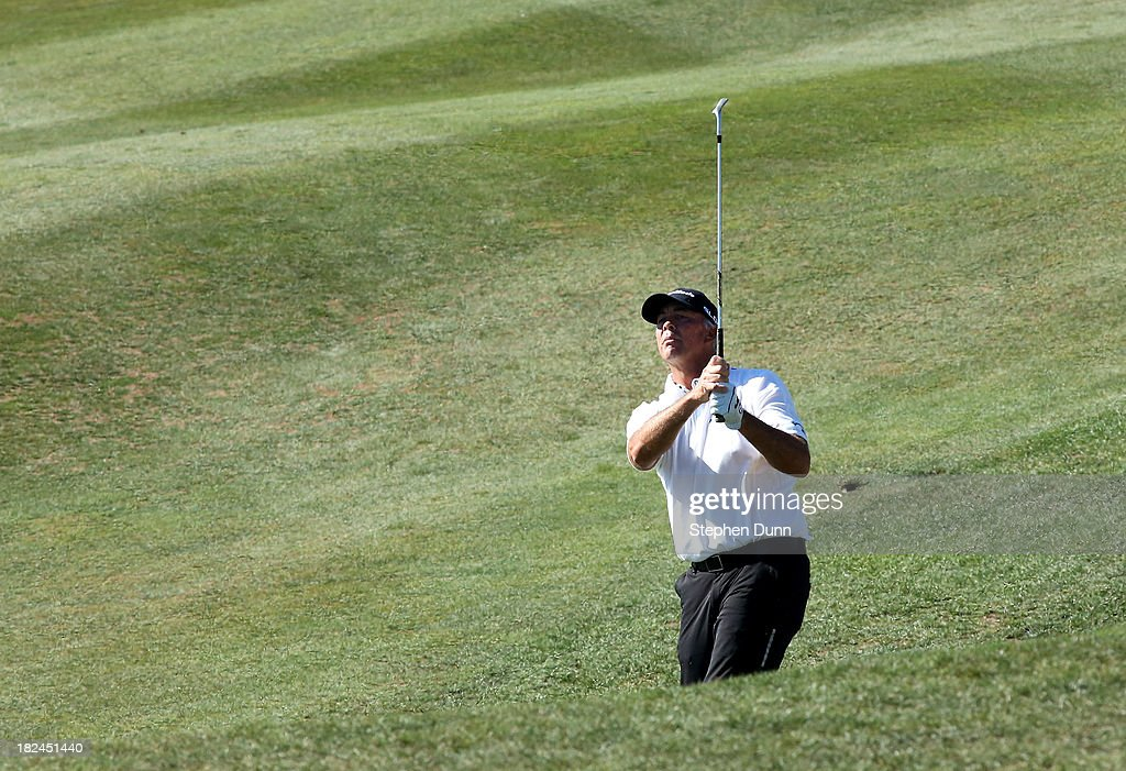 <a gi-track='captionPersonalityLinkClicked' href=/galleries/search?phrase=Tom+Lehman&family=editorial&specificpeople=184539 ng-click='$event.stopPropagation()'>Tom Lehman</a> hits to the green on the ninth hole durng the final round of the Nature Valley First Tee Open at Pebble Beach at Pebble Beach Golf Links on September 29, 2013 in Pebble Beach, California.