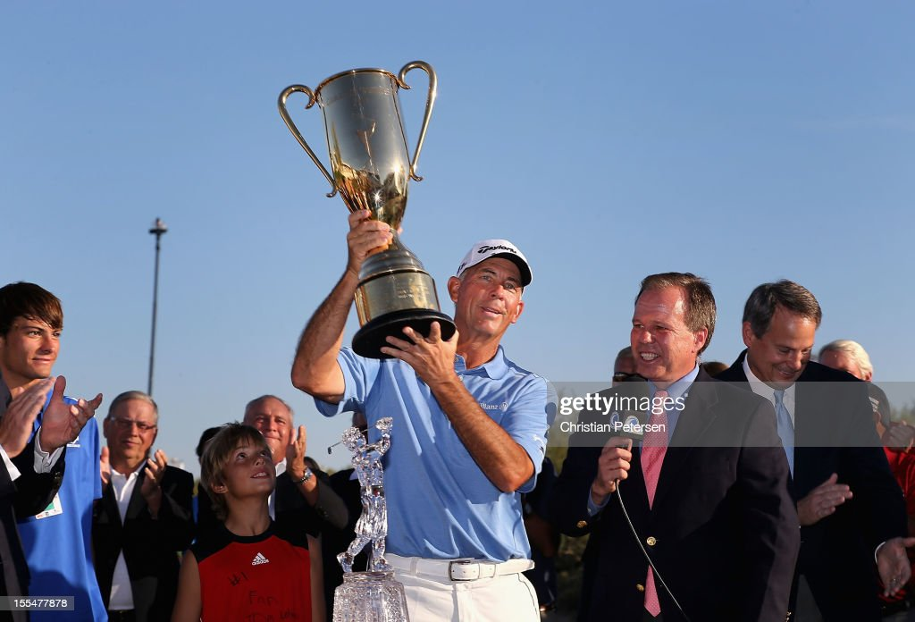 Tom Lehman hoists the Schwab Cup after winning the Charles Schwab Cup Championship on the Cochise Course at The Desert Mountain Club on November 4...