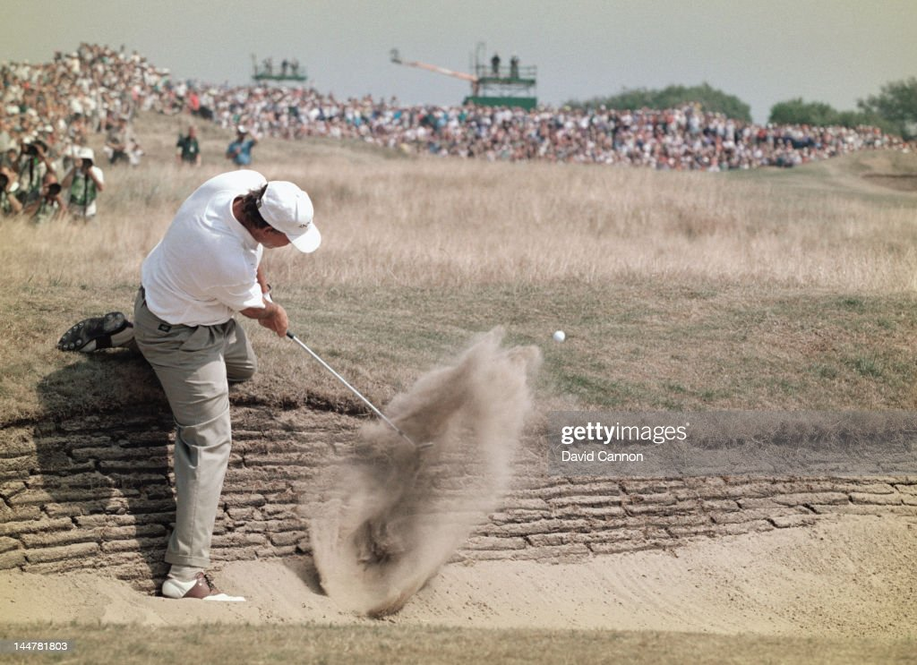 Tom Lehman of the United States chips out of the 3rd hole bunker during the 125th Open Championship on 21st July 1996 at the Royal Lytham and St...