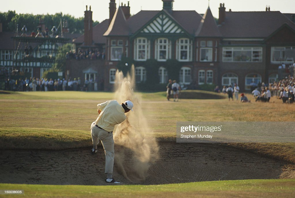 Tom Lehman of the United States hits out of a bunker during the 125th Open Championship on 21st July 1996 at the Royal Lytham and St Annes Golf Club...
