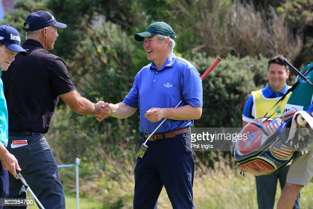 Tom Lehman of the United States shakes hands with David Richards Captain of Royal Porthcawl Golf Club during the ProAm ahead of The Senior Tour Open...