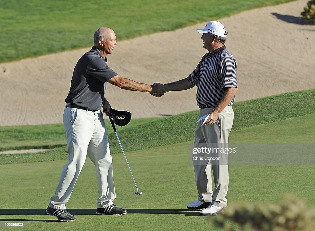 <a gi-track='captionPersonalityLinkClicked' href=/galleries/search?phrase=Tom+Lehman&family=editorial&specificpeople=184539 ng-click='$event.stopPropagation()'>Tom Lehman</a> shakes hands with <a gi-track='captionPersonalityLinkClicked' href=/galleries/search?phrase=Jay+Haas&family=editorial&specificpeople=204209 ng-click='$event.stopPropagation()'>Jay Haas</a> on the 18th hole during the third round of the Charles Schwab Cup Championship at Desert Mountain Club (Cochise) on November 3, 2012 in Scottsdale, Arizona.