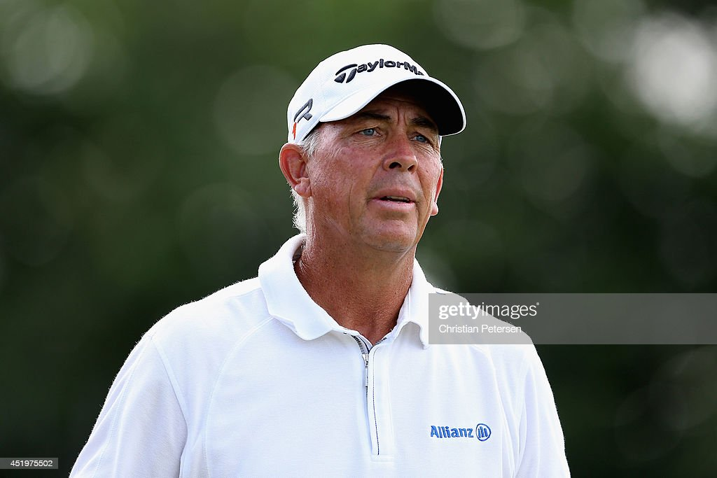 Tom Lehman watches his tee shot on the 17th hole during the first round of the 2014 US Senior Open Championship at Oak Tree National on July 10 2014...