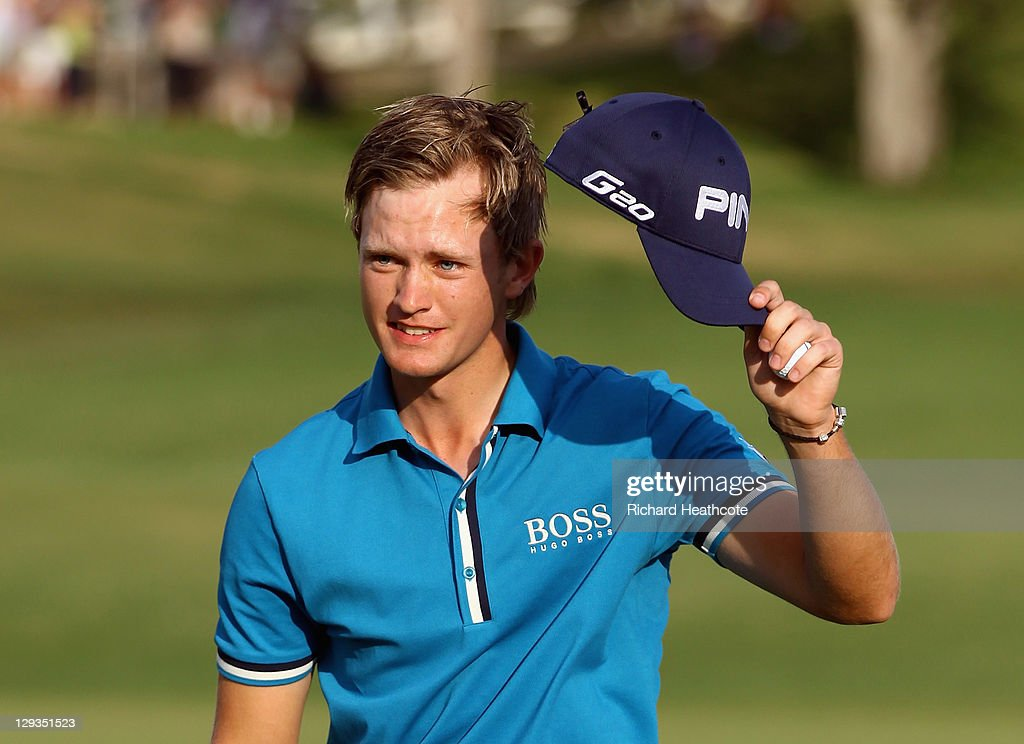 Tom Lewis of England acknowledges the crowd after finishing his round on the 18th green during the final round of the Portugal Masters at Oceanico...