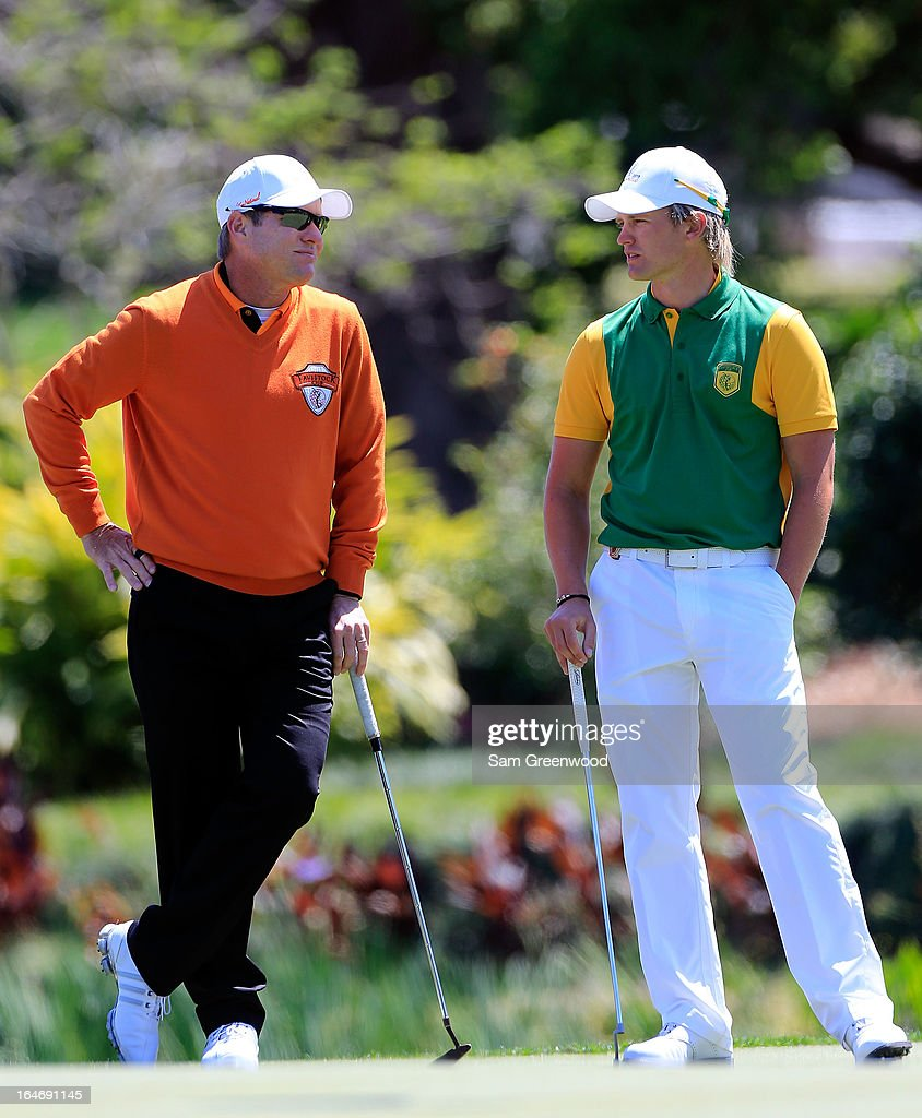 Tom Lewis of England and Team Queenwood (R) speaks with Scott Verpalnk of Team Oak Tree National during the second day of the Tavistock Cup at the Isleworth Golf and Country Club on March 26, 2013 in Windermere, Florida.