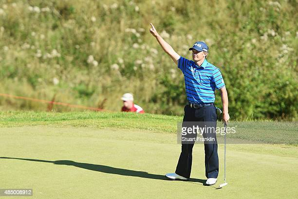 Tom Lewis of England celebrates a putt during the final round of the Made in Denmark at Himmerland Golf Spa Resort on August 23 2015 in Aalborg...