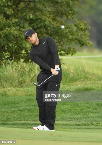 Tom Lewis of England chips onto the 12th green during the final round on day four of the DD REAL Czech Masters at Albatross Golf Resort on September...