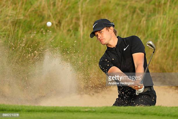 Tom Lewis of England hits from a bunker on the 7th hole during the first round of Made in Denmark at Himmerland Golf Spa Resort on August 25 2016 in...