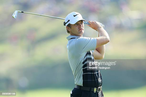 Tom Lewis of England hits his second shot on the 4th hole during the second round of Made in Denmark at Himmerland Golf Spa Resort on August 26 2016...