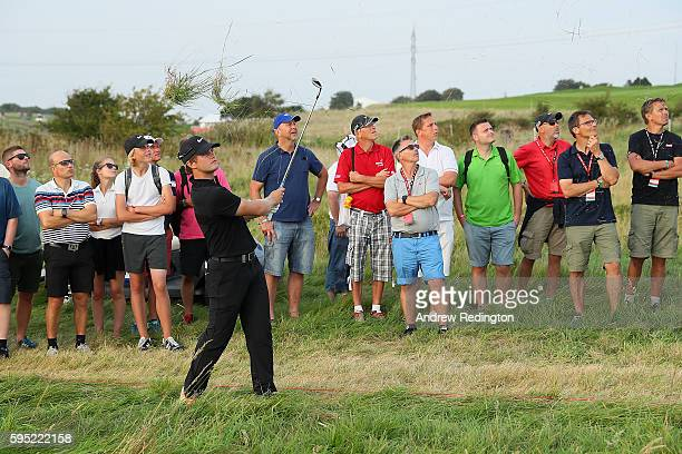 Tom Lewis of England hits his second shot on the 8th hole during the first round of Made in Denmark at Himmerland Golf Spa Resort on August 25 2016...