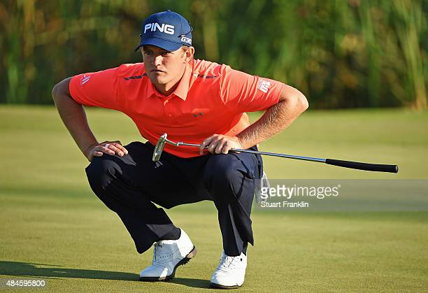 Tom Lewis of England lines up a putt during the first round of the Made in Denmark at Himmerland Golf Spa Resort on August 20 2015 in Aalborg Denmark